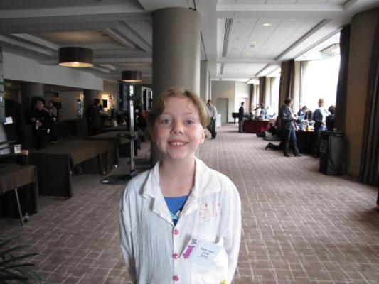 Sylvia stands in the lobby room of the DML 2012 Conference