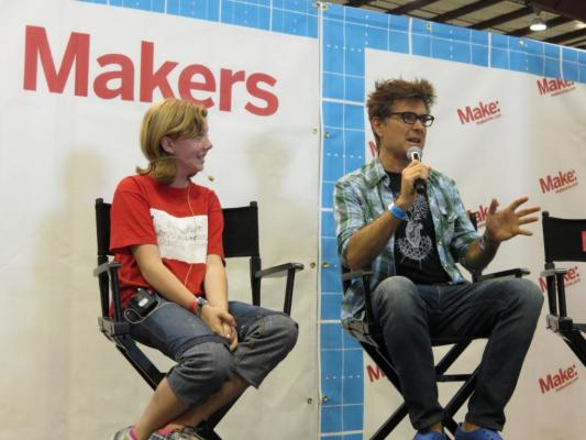 Sylvia sits on stage at Maker Faire Bay Area 2013 being interviewed by Mark Frauenfelder, Editor in Chief of Make Magazine.