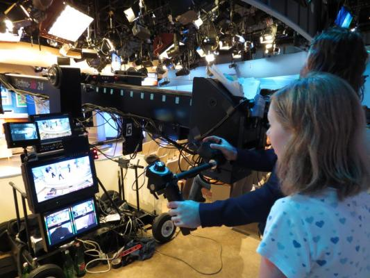 Sylvia standing with the jib camera operator on stage at ABC studios in New York for the Katie Couric show.
