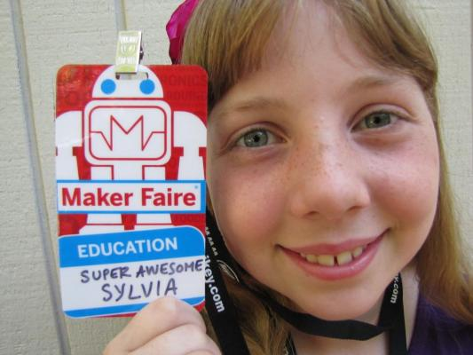 Sylvia posing with her preliminary Maker Faire Badge