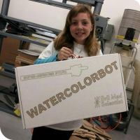 "Sylvia posing with her custom made white cardboard box that reads ""Super-Awesome Sylvia - WATERCOLORBOT - Evil Mad Scientist"""