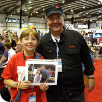 Sylvia posing with Dale Dougherty holding a picture of them at Maker Faire 2011