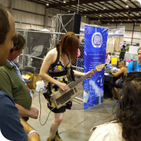 Jeri Ellsworth showing off her Commodore-64 bass guitar project