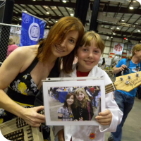 Jeri Ellsworth posing with Sylvia and a picture of them from Maker Faire 2011