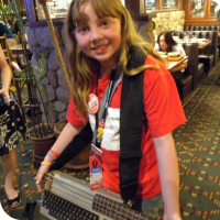 Sylvia posing with Jeri's C-64 Bass guitar.