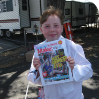 Sylvia holding a signed Make Magazine Schools out Special Edition