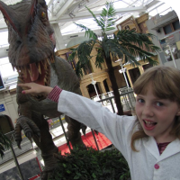 "Sylvia getting ""bitten"" by a utahraptor in Science City, Union Station."