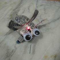Sylvia's mousey the junkbot with red indicator led