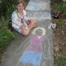 Sylvia with chalk drawing of herself