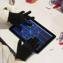 Sylvia uses a capacitive touchscreen on a tablet computer with gloves on